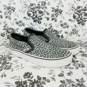 Vans black and white cheetah slip ons
